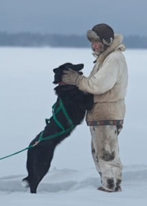 A musher and dog moment