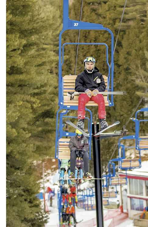 Skiers on chair lift at Lost Valley. Brewster Burns.