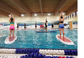 Indoor paddleboard yoga at Riverton Pool. Photo: Shannon Bryan