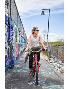 Riding along the Eastern Promenade Trail in Portland, past the renowned graffiti wall.